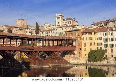 Famous old wooden bridge (Ponte Vecchio) in village Bassano del Grappa Italy poster