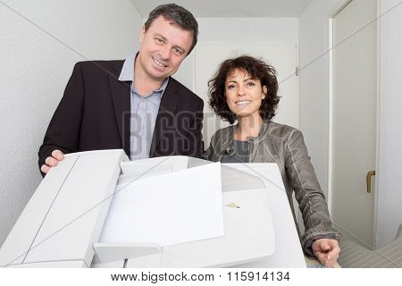 Two Product Designers, Standing Behind A Copy Machine