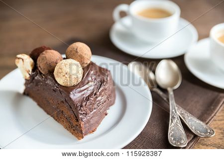Portion Of Sacher Torte With Two Cups Of Coffee