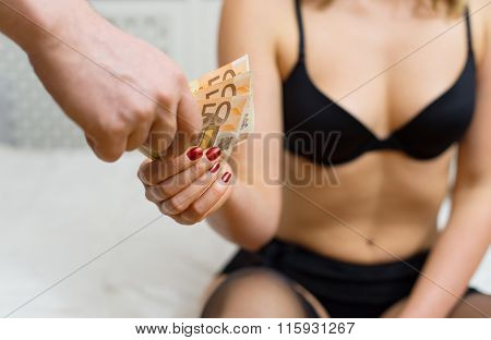 Prostitute is taking money for her work.