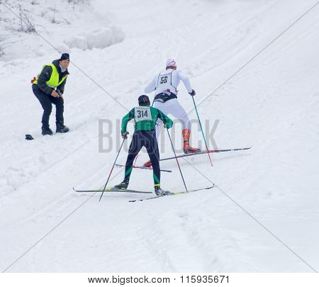 STOCKHOLM - JAN 24 2016: Two cross country skiing men sprinting uphill at the Stockholm Ski Marathon event January 24 2016 in Stockholm Sweden