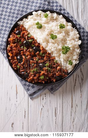 Picadillo A La Habanera With Rice On The Table. Vertical Top View