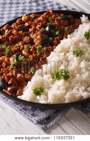 Cuban Food: Picadillo With A Side Dish Of Rice Close-up. Vertical