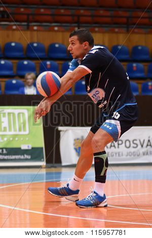 KAPOSVAR, HUNGARY - JANUARY 16: Mark Deak receives the ball at a Hungarian National Championship volleyball game Kaposvar (green) vs. Sumeg (blue), January 16, 2016 in Kaposvar, Hungary.