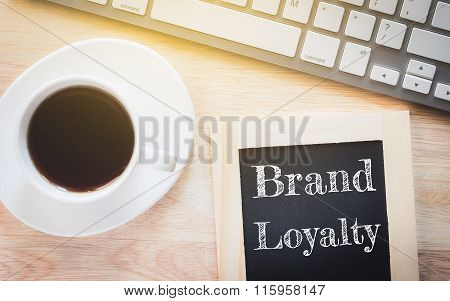 Concept BRAND LOYALTY message on wood boards.