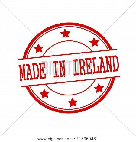 Made In Ireland Red Stamp Text On Red Circle On A White Background And Star