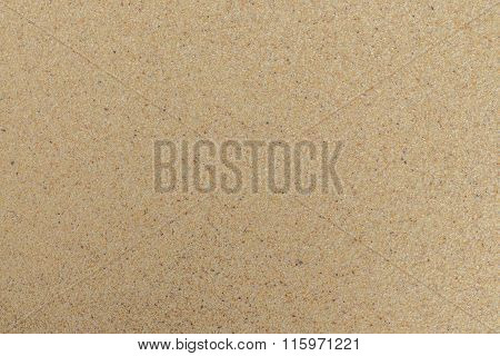 Closeup Of Sand Pattern Of A Beach In The Summer. Beach Background.