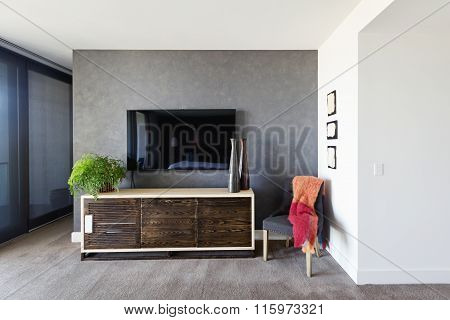 Wall Mounted Tv And Buffet In Spacious Master Bedroom