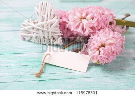 White Decoratve Heart With Hyacynths, Willow Flowers And Empty Tag