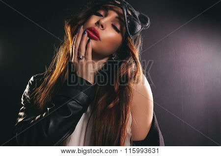 beautiful girl with closed eyes in a cat mask
