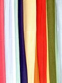 bunch of cotton scarves in different colors poster