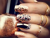 Golden Nail art manicure. Holiday style bright Manicure with gems and sparkles. Bottle of  Nail Polish. Fashion rings with diamonds, Trendy Accessories. Beauty hands. Stylish Nails, Nailpolish poster