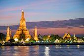 Night view of Wat Arun temple and Chao Phraya River Bangkok Thailand poster