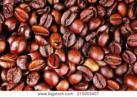 Coffee texture. Roasted coffee beans as background wallpaper. Beautiful arabica real cofee bean illustration for any concept. Gourmet coffee beans macro closeup studio photo. Texture background.