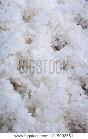Salt crystals. Salt texture patter closeup. Salt crystal as background. Salt texture.