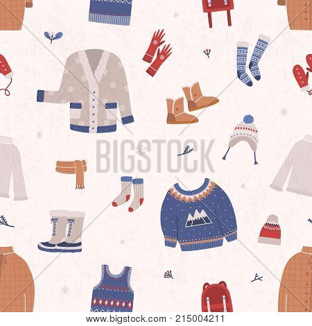Seamless pattern with winter clothes and outerwear on light background. Backdrop with warm seasonal clothing or apparel. Cartoon vector illustration for wallpaper, wrapping paper, textile print