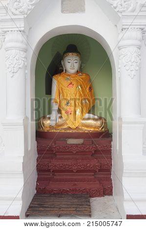 Little Buddha in Shwedagon pagoda Yangon Myanmar .