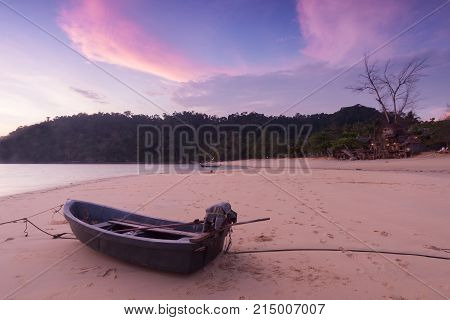 Little boat on the beach at Twilight time.