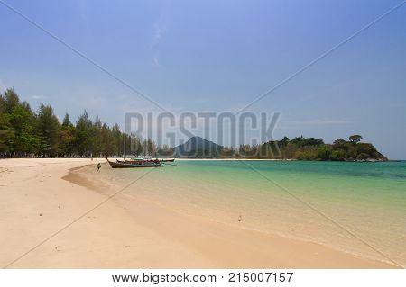 Tropical sea and white sand at Krabi , Thailand .