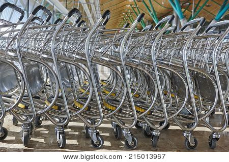 Trolleys at airport railway bus station. Travel background. Horizontal