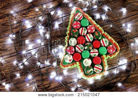 Christmas Tree with Ornamenst on Wooden Background