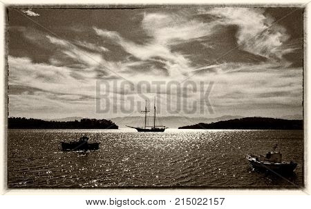 Fishing and sailing boats in the bay. Fine art image canvas texture and frame added.Sepia tone