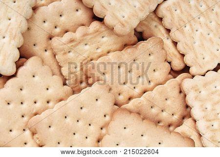Biscuit. Texture background. Biscuits biscuit texture stack of biscuit crumpet tea biscuit pattern. Crumpets as background. Biscuits crumpet pattern texture. Chocolate coated biscuits.