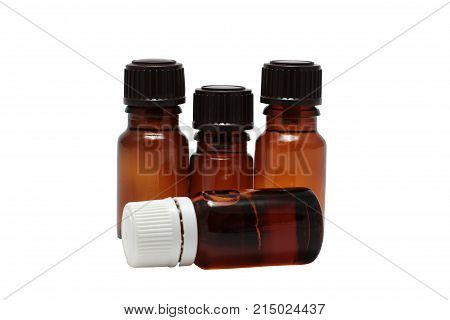 four bottles of aromatherapy oils isolated close-up