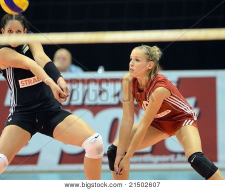 BUDAPEST, HUNGARY - JUNE 18: Zsuzsanna Jozsa (in black 4) in action at a CEV European League woman's volleyball game Hungary vs Czech Republic on June 18, 2011 in Budapest, Hungary.