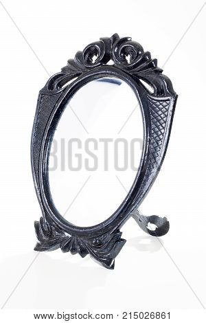 Black toy mirror On isolated white studio background. Clipping path. Single object on white background. Black cosmetic mirror with frame.