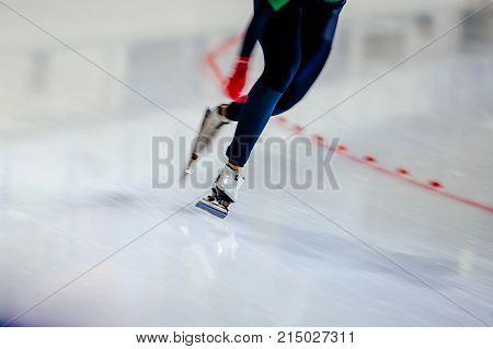 woman legs athlete speed skater blurred motion