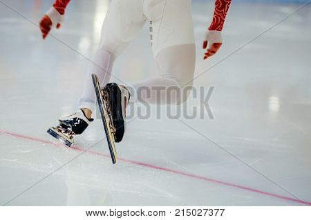 start legs men athletes speed skaters in competition speed skating