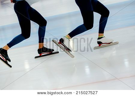 synchronous motion legs two athletes speed skaters on ice rink