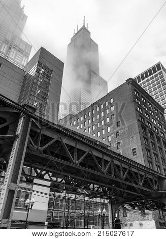 Chicago - March 2017, IL, USA: View of The Willis Tower (Sears Tower) and surrounding buildings in foggy weather.