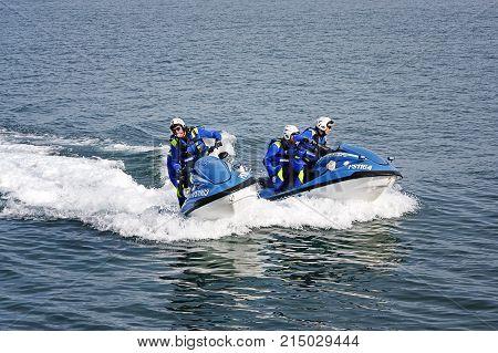Rome Italy - May 9 2009: Maritime police agents special police department of Italy train at sea with waterbodies in a public exercise during the celebrations of the 157th anniversary of the police foundation.