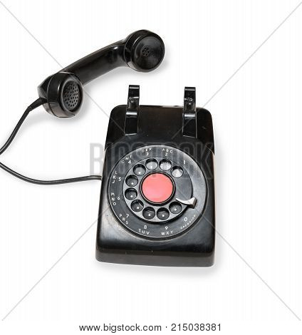 Old and antique rotary telephone isolated against white background
