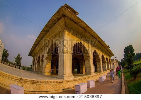 DELHI, INDIA - SEPTEMBER 25 2017: Unidentified people walking around Inlaid marble, columns and arches, Hall of Private Audience or Diwan I Khas at the Lal Qila or Red Fort in Delhi, India, fish eye effect.