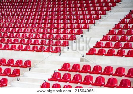side view of empty  red stadium seats