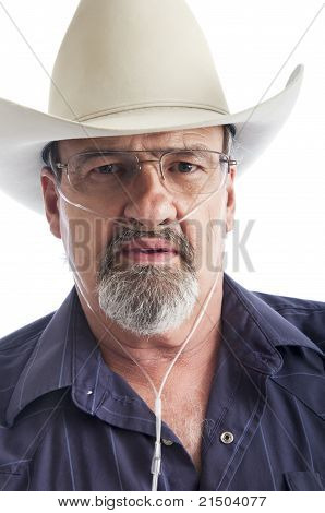 Adult Man Wearing A Cowboy Hat And Oxygen Hose