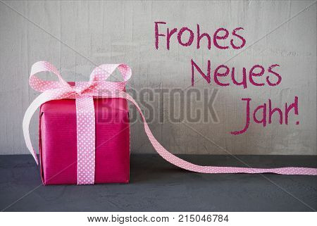 Gray Grungy Cement Wall With German Text Frohes Neues Jahr Means Happy New Year. Pink Gift Or Present With Bow.