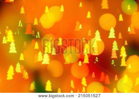 Abstract circular bokeh background of Christmaslight with christmas tree