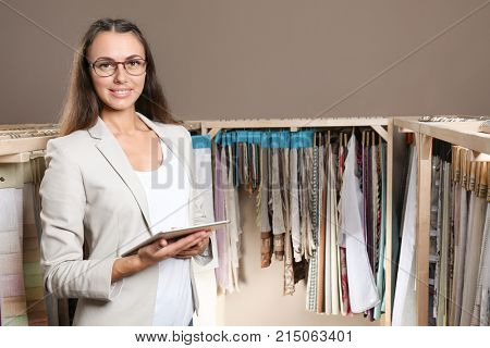Young shop assistant in drapery store