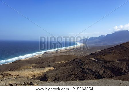 a panoramic view of the southwestern coast of the natural park of Jandia, in Fuerteventura, Canary Islands, Spain, highlighting the lonely Cofete Beach