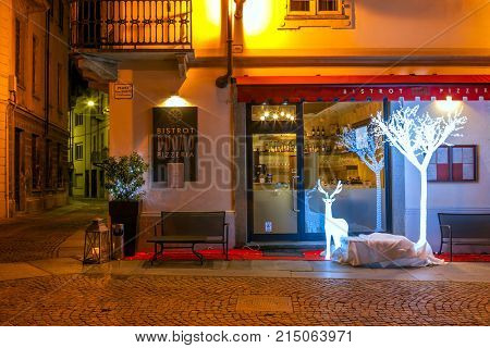 ALBA, ITALY - DECEMBER 06, 2012: Small restaurant decorated for Christmas celebrations in Alba - town in Piedmont, capital of hilly area of Langhe, is famous for white truffles.