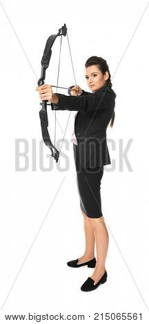 Young woman in formal clothes practicing archery on white background