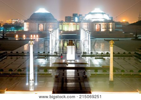 Aerial shot of Ambedkar park with the central pillar, lit pillars and the musems in the background. Shows the beautiful courtyard of the landmark