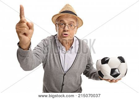 Angry senior with a deflated football arguing and gesturing with his finger isolated on white background
