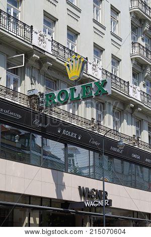 VIENNA AUSTRIA - JULY 12 2015: Rolex Clock Sign at Wagner Shop Exterior in Vienna Austria.