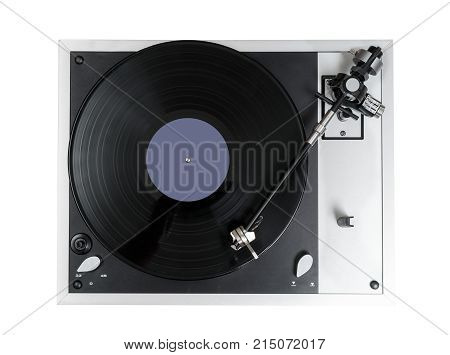Aerial view top down onto a playing vinyl record on vintage hi-fi stereo turntable isolated against white background