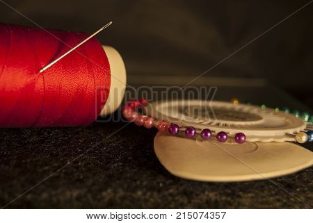 Set tailor: red thread with a needle white chalk for drawing a set of multicolored pins